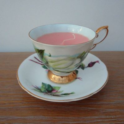 Etsy candle in a teacup via LMDvintage