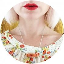 Pip Jolley orange roller necklace