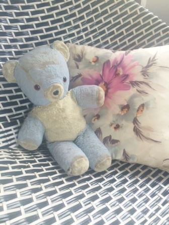 Vintage teddy bear from Kate Beavis Vintage Home blog sitting on a 1950s tub chair