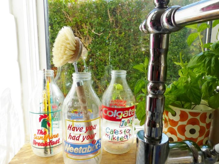 Wooden washing up brush in 1980s advertising milk bottles on kate Beavis Vintage Home blog