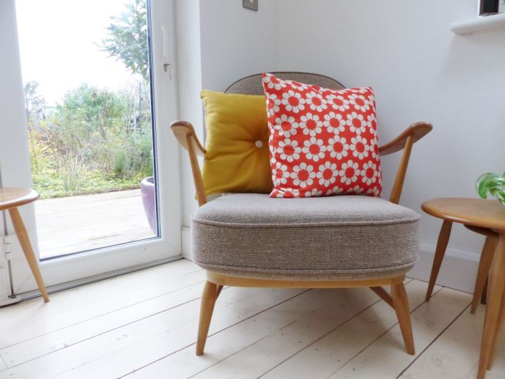 Vintage Style Hunkydory Home orange cushion on Ercol as featured on Kate Beavis Vintage Home blog