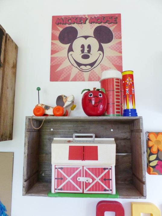 A vintage children's room by Kate Beavis.com, vintage crates as shelves with vintage toys on