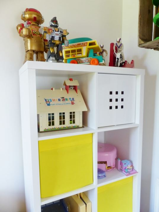 A vintage children's room by Kate Beavis.com, Ikea shelving and vintage toys