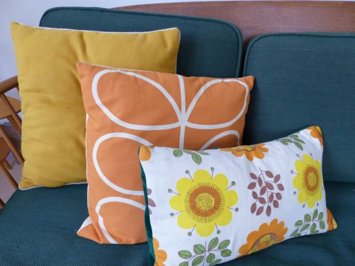 Vintage cushions, Ercol studio couch Creating an autumnal home and discovering Hygge by Kate Beavis.com