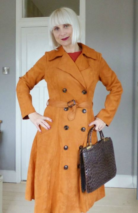 A 1960s vintage reproduction mac from Collectif's Bright and Beautiful collection by Kate Beavis