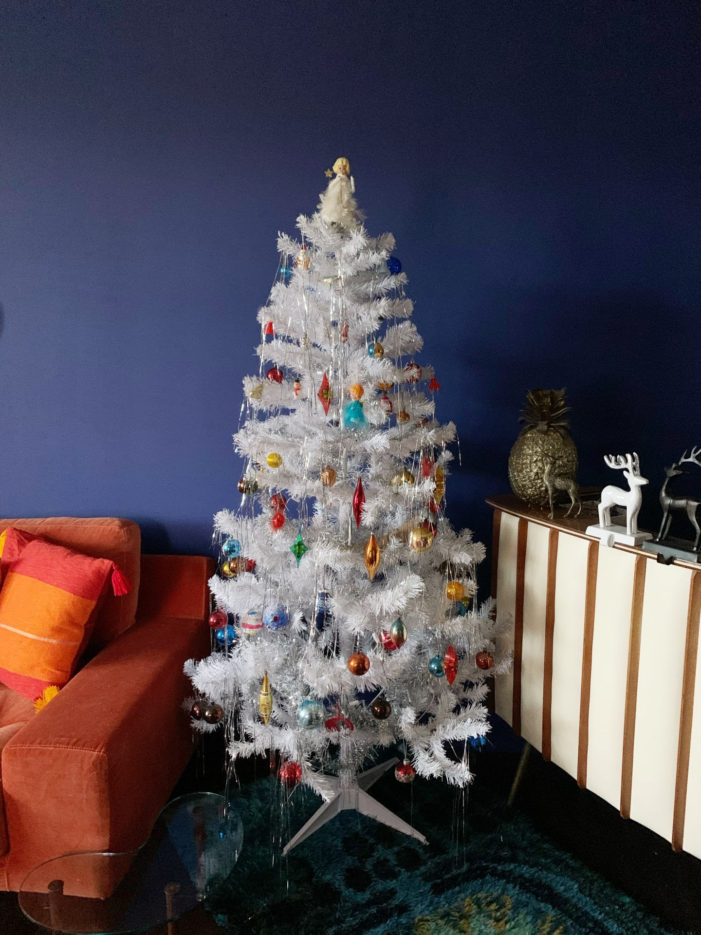 Our Vintage Christmas Decorations on a white tree with blue walls